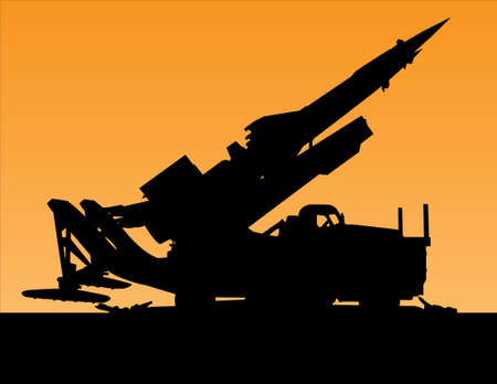 launcher: silhouette of a rocket launcher on the machine against the orange sunset