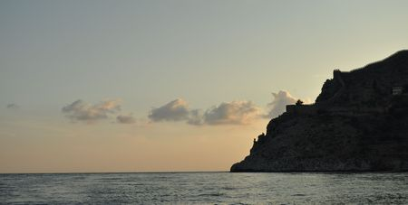 sihlouette: Medieval castle on the seaside at sunset Stock Photo