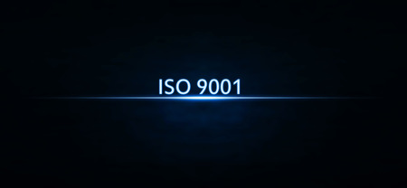 ISO 9001 text on blue light.