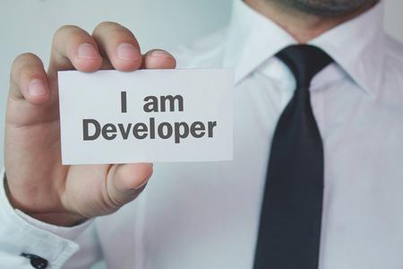 Text I am Developer on a business card.