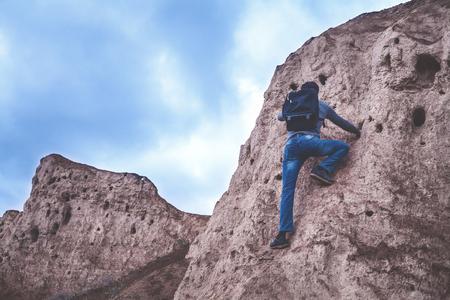 Man climbing the mountain. Stock Photo