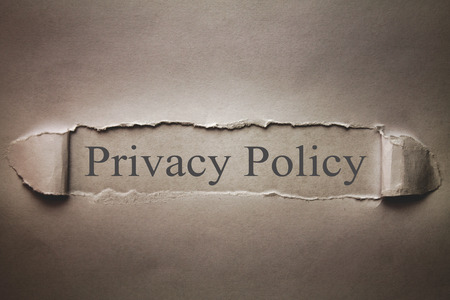 Privacy Policy word on the torn paper.