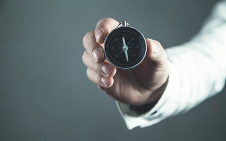 Man showing compass. Business concept