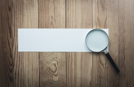 Magnifying glass with blank paper. Search and discover 版權商用圖片