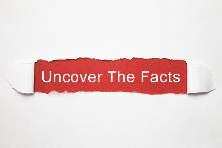 Uncover The Facts on torn paper. Stock Photo