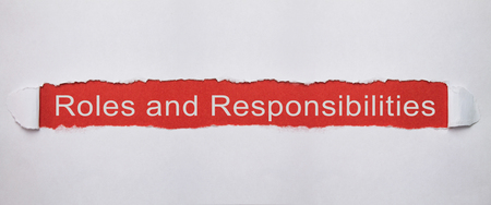 Roles and Responsibilities on torn paper. Stock Photo