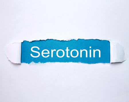 Word Serotonin on torn paper.