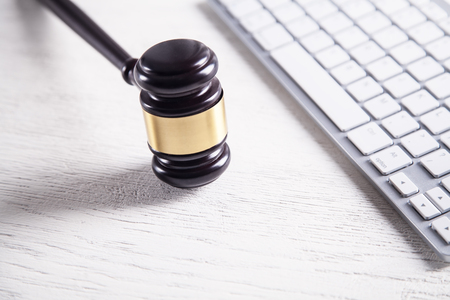 Judge gavel with computer keyboard. Concept of internet crime. Law and Justice