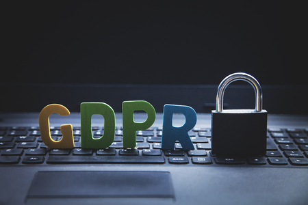 GDPR General Data Protection Regulation. Padlock with colorful word on laptop keyboard. Stock Photo