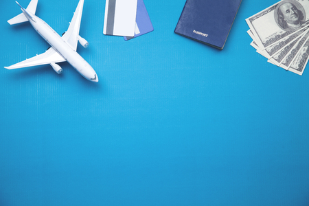 Toy airplane, credit cards, dollars and passport. Travel concept Фото со стока - 119950594