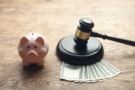 Judge gavel with money and piggy bank. Stock fotó