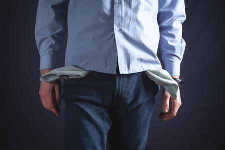 Man with empty pocket. No money Banco de Imagens