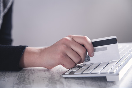 Hand holding credit card. Online shopping