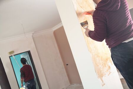 Plastering a wall with spatula. Renovation