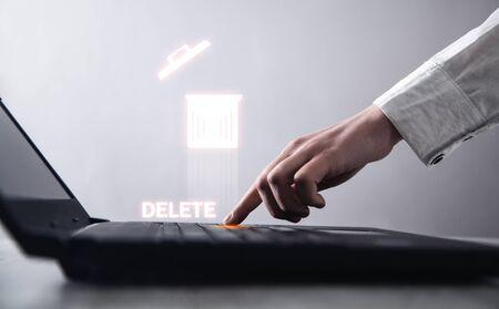 Hand typing laptop keyboard. Delete 免版税图像