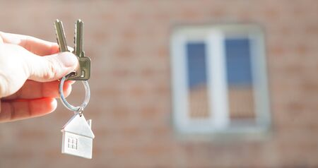Real estate agent holding keys of the house.