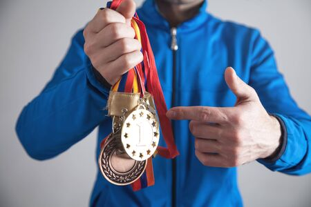 Sportsman with medals. Sport, Winner, Success