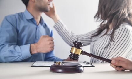 Caucasian angry couple fighting. Judge holding gavel. Divorce