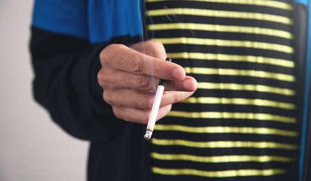 Man smoking cigarette. Concept of smoking