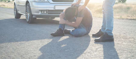 Car driver helping accident victim. People, Life, Car driving
