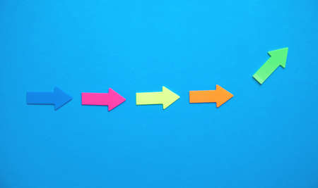Colorful arrows on blue background.
