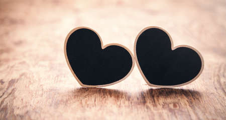 Wooden hearts on wooden table.