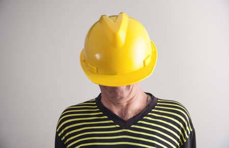 Worker with a yellow helmet.