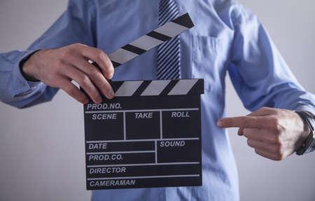Man holding movie clapper. Making movie