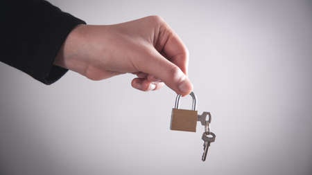 Man showing padlock with a keys. Security concept