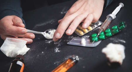 Drug addict taking cocaine. Addiction
