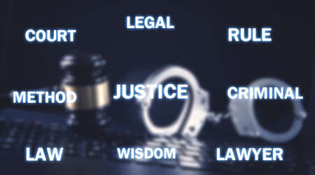 Handcuffs and Judge gavel on computer keyboard. Justice 스톡 콘텐츠