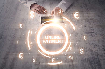 Hands using tablet. Online Payment