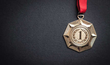 Medal awards for winner on black background.