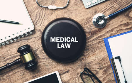 Wooden judge gavel with a other objects. Medical Law 스톡 콘텐츠