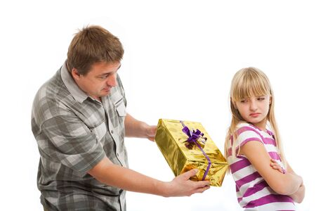 Father trying to give a christmash gift to his daughter but she rejects it. Isolated on white background.
