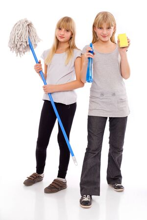 Ready for domestic work - teen girls with cleaning utensils