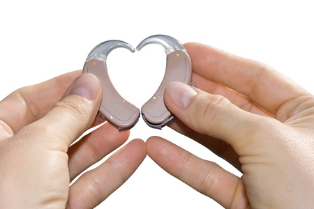 listening device: Hands showing a heart shape from digital hearing aids  Isolated on white