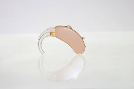 Single used analog hearing aid with its reflection
