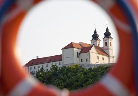 Tihany Abbey framed by a life belt. Stock Photo - 17617724