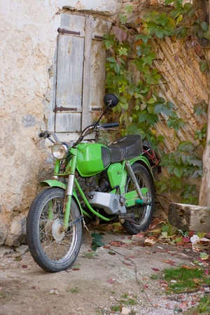 unk green motorbicycle in autumnal circumstances from the Balkan. Stock Photo