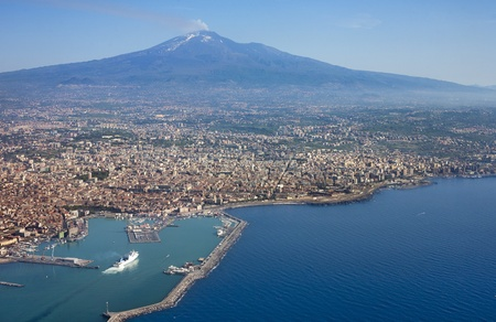 Air photo of Catania city in Sicily with the Etna Vulcan in the back.