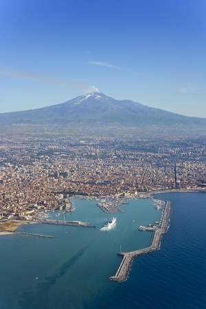 catania: Birds eye view of Catania city in Sicily with the Etna Vulcan in the back.