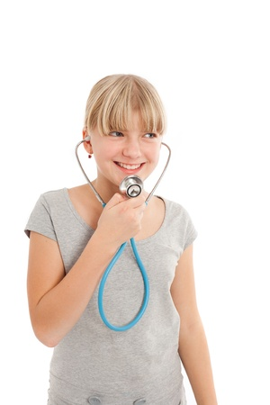 Young female speaking in a stethoscope. Isolated on white photo