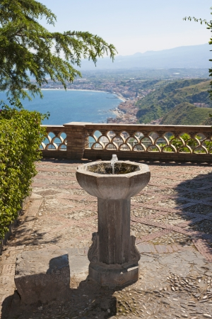 Antique drinking fountain in Taorminas park, in Sicily, Italy