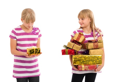 favoritism: Girl with lots of gifts looking at another girl sarcastically having only a small gift and disappointed. Isolated on white.
