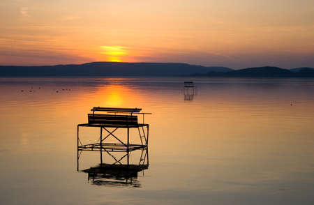 Lake Balaton after sunset with angler piers. Stock Photo - 17617648