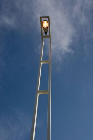An illuminating modern lamppost with clipping path. Stock Photo - 17617642