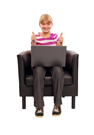 Laptop girl happy giving thumbs up success sign sitting at computer PC with excited face expression. Beautiful smiling cheerful Caucasian student girl on white background. Stock Photo