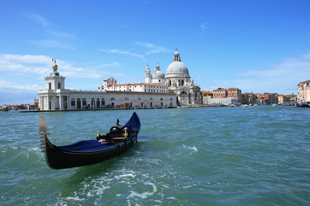 Loose gondola on the Canal Grande in front of the Le Salute Temple (and the toll-house) in Venice, Italy. photo