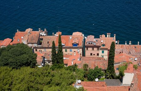 Bird eye view of old mediterranean houses at the beach of Adriatic Sea. photo
